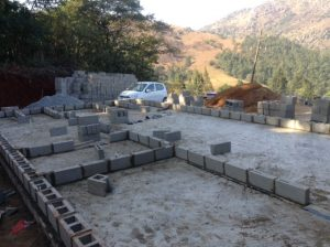 First course of bricks are laid.