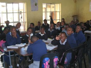 A classroom of PIES children wearing uniforms made by the local women